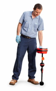 plumbing contractor uses a leak detection device